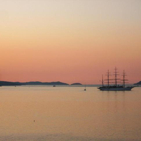 Ship sails at Sunset on Adriatic Sea near Korcula Island, Croatia