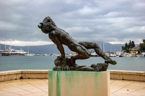 Statue of man in Lumbarda on Korcula Island, Croatia