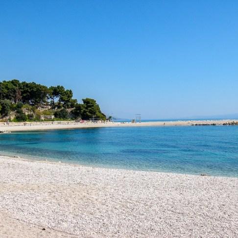 Pebble shoreline at Trstenik Beach in Split, Croatia