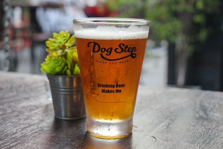 Glass of craft beer at Dog Step in Beacon Place in On Nut Bangkok, Thailand