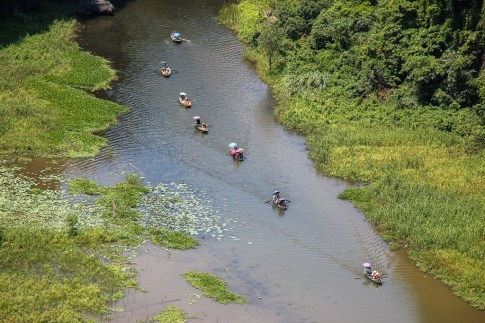 Rowboats on river in Ninh Binh, Vietnam