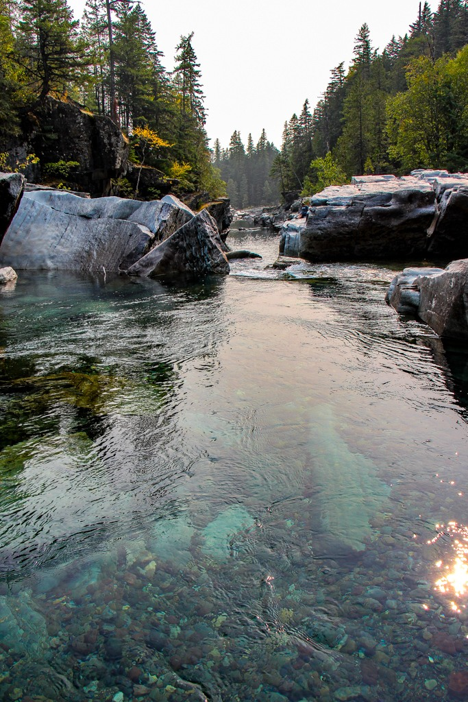 Clear blue water at Upper McDonald Creek Trail Waterfalls, Glacier National Park, Montana