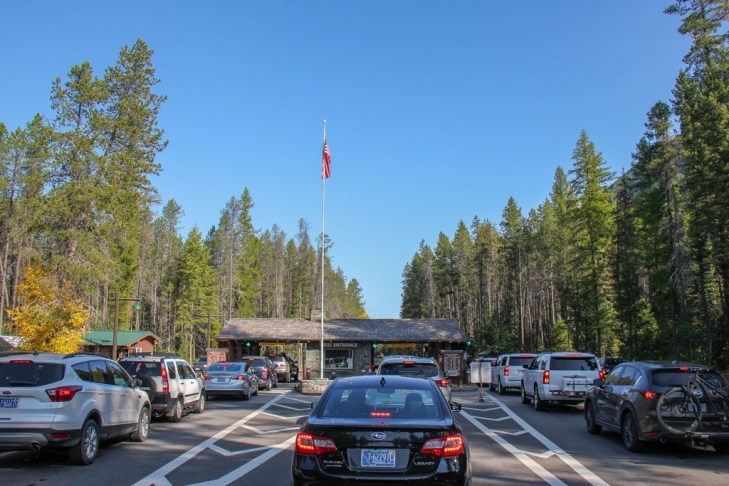Cars waiting at the West Entrance, Glacier National Park, Montana