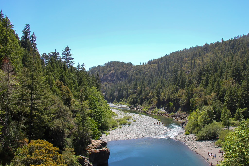 People enjoying the banks of the Smith River, California