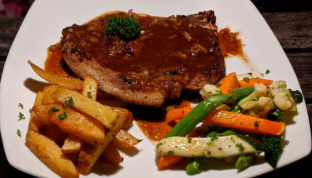 Grilled porkchop with sauce