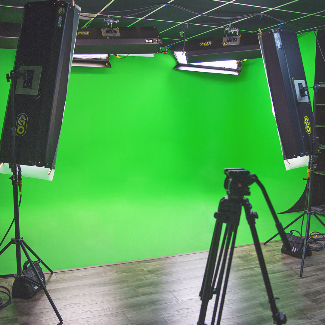 Image of a video recording studio with green screen