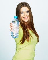 young woman show bottle of water