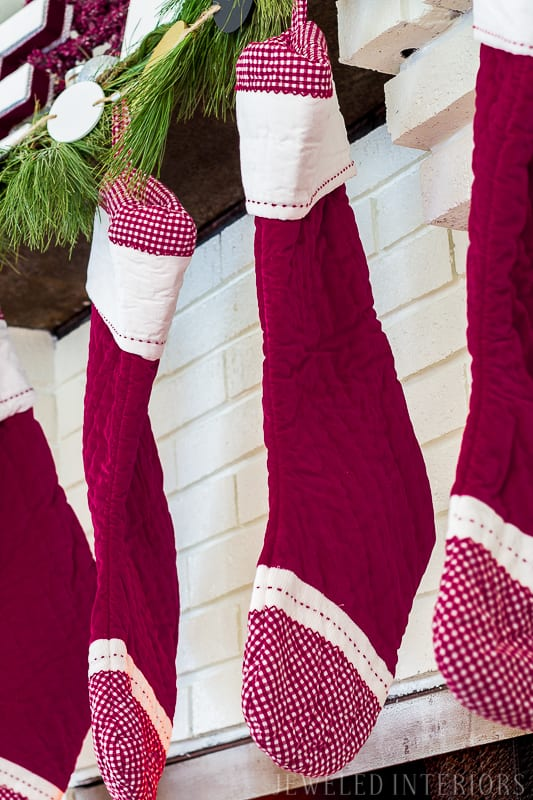 Holiday Home tour || Red pottery barn stockings, mantle, greeney, swag, HOLIDAY HOME TOUR REVEAL || THIS TREE|| Looking for inspiration for Christmas? Jeweled Interiors, Holiday, Home Tour, Burgundy, cranberry, blush, Decor, Ideas, Tips, black, Christmas, tree, decor, decorations, DIY, inspiration, red, maroon, wine, home tour, poinsettia, glam, chic, peach, gold, black, white, garland, antique, mirror