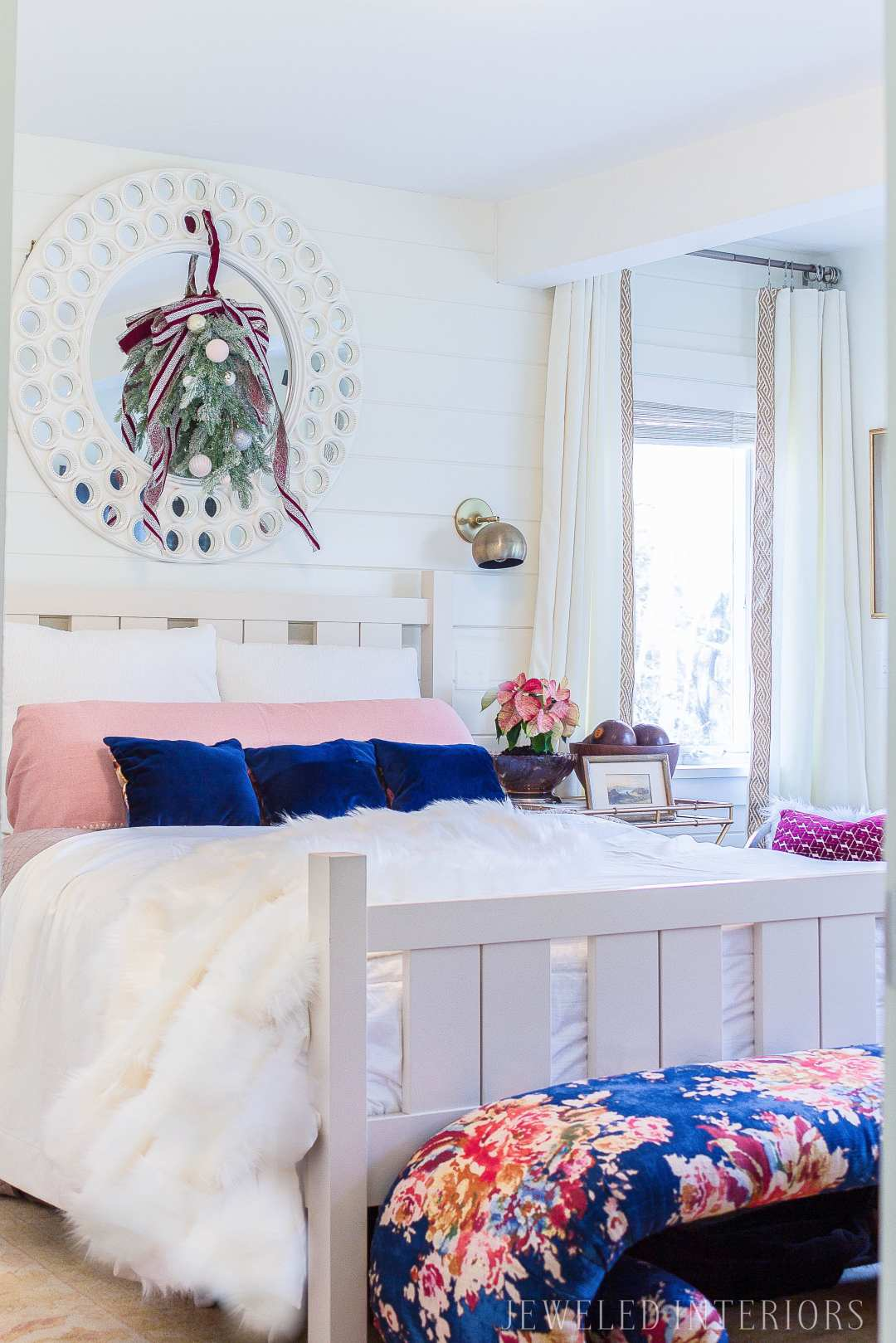 A white bedroom with pops of color: Looking for inspiration for a eclectic, chic, an glam Christmas? You have got to see this! Jeweled Interiors, Holiday, Home Tour, Burgundy, cranberry, blush, Christmas, Decor, Ideas, Tips, wreaths, Christmas, tree, decor, decorations, DIY, inspiration, red, maroon, wine, home tour, poinsettia, glam, chic, peach, gold, black, white