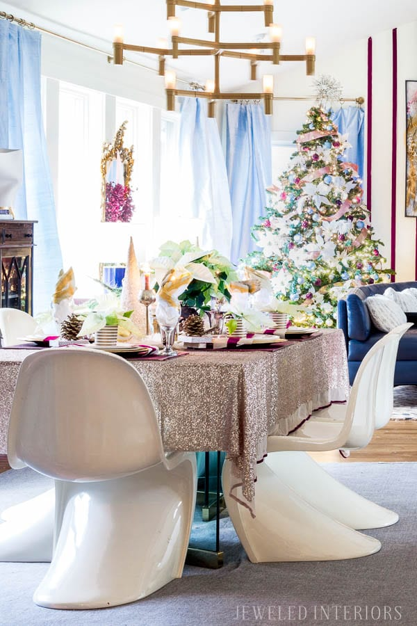 THIS DINING ROOM! Looking for inspiration for a eclectic, chic, and glam Christmas? Jeweled Interiors, Holiday, Home Tour, Burgundy, cranberry, blush, Decor, Ideas, Tips, wreaths, Christmas, tree, decor, decorations, DIY, inspiration, red, maroon, wine, home tour, poinsettia, glam, chic, peach, gold, black, white, Panton, chairs, brass, chandelier, tablescape, pinecones