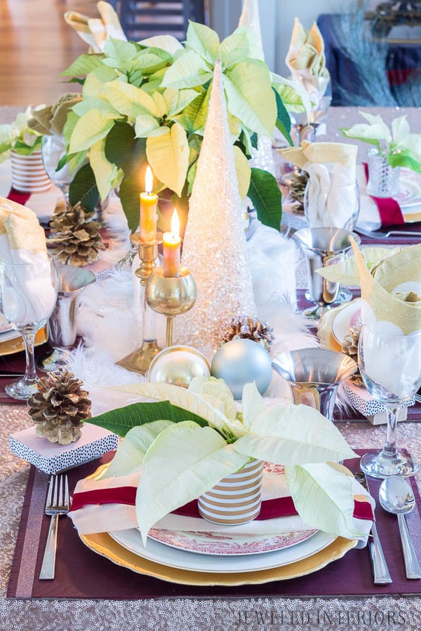 A Poinsettia tablescape: Looking for inspiration for a eclectic, chic, an glam Christmas? You have got to see this! Jeweled Interiors, Holiday, Home Tour, Burgundy, cranberry, blush, Christmas, Decor, Ideas, Tips, wreaths, Christmas, tree, decor, decorations, DIY, inspiration, red, maroon, wine, home tour, poinsettia, glam, chic, peach, gold, black, white