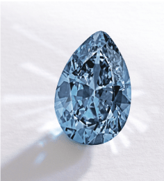 A rare 9.74ct Fancy Vivid blue diamond, part of Sotheby's sale of Jewels & Objects of Vertu from the collection of Mrs Paul Mellon, broke two world records when it was sold for $32.6 million