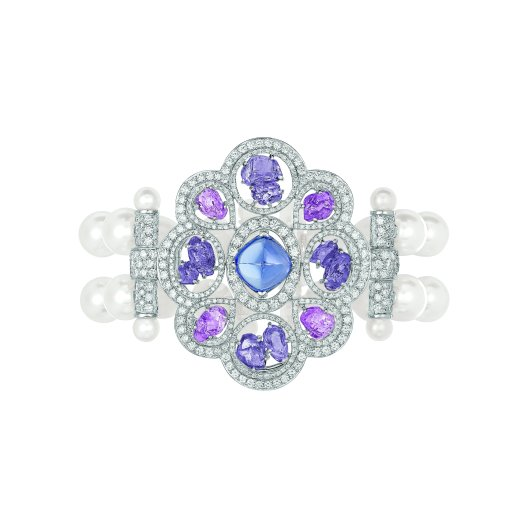 """Charismatique"" bracelet in 18K white gold set with a 4.5-carat sugarloaf-cut blue tanzanite, 4 baroque-cut pink sapphires for a total weight of 4.4 carats, 8 baroque-cut violet sapphires for a total weight of 5.6 carats, 667 brilliant-cut diamonds for a total weight of 5 carats and 52 Japanese cultured pearls. CHANEL Joaillerie"