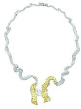 Dénoué Diamant Necklace. 750/1000 white and yellow gold, diamonds and yellow diamonds.