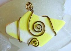 yellow polkadotted sea pottery pendant €20