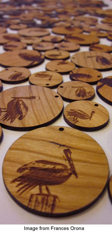 Laser etched wooden earrings by Frances Orona