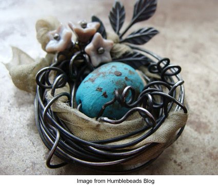 tiny bird's nest made from wire with blue egg bead