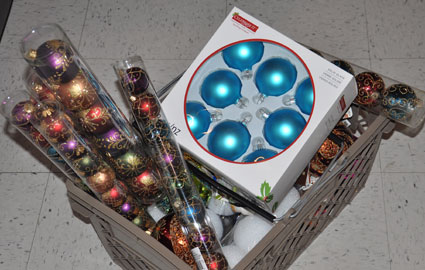 Overflowing handbasket of holiday decorations ready for the Dream Tree Challenge!