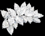 This platinum brooch is set with 18 pear-shaped diamonds (30.90ctw).