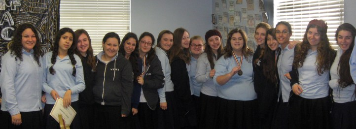 Girls Debate Squad w medals cropped