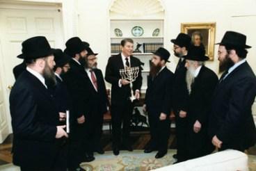 Rabbi Raichik, second from right, along with fellow Chabad Shluchim presenting a Menorah to President Reagan