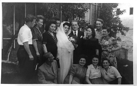 wedding of Eva and Mendel in Pfaffenberg Germany, 1946. To the right of Eva is her sister Miriam and between them, Miriam's husband Chaim (of their same town). To the left of Mendel is his sister Rose. They are surrounded by other survivors living nearby