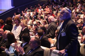Holocaust survivors in the audience being acknowledged