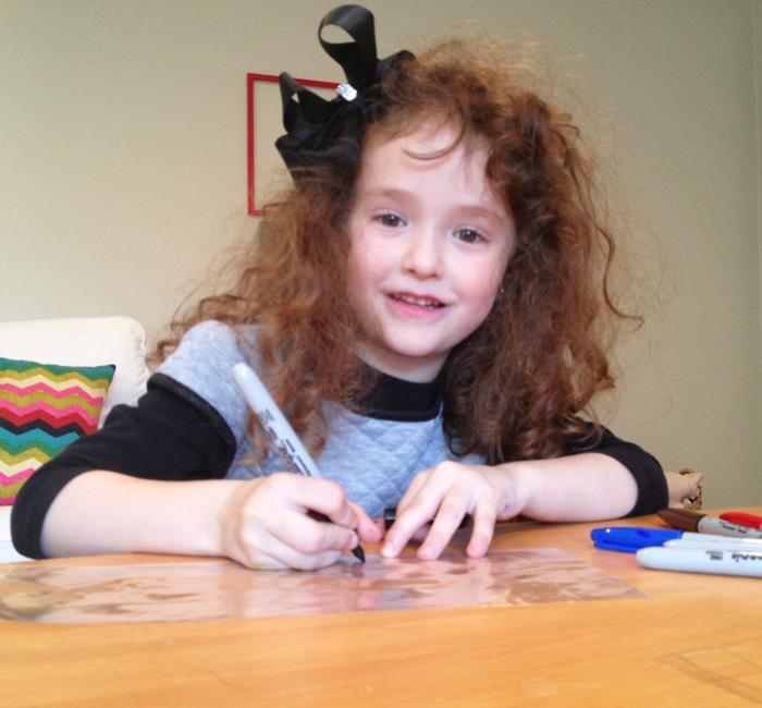 Child decorating mishloach manot