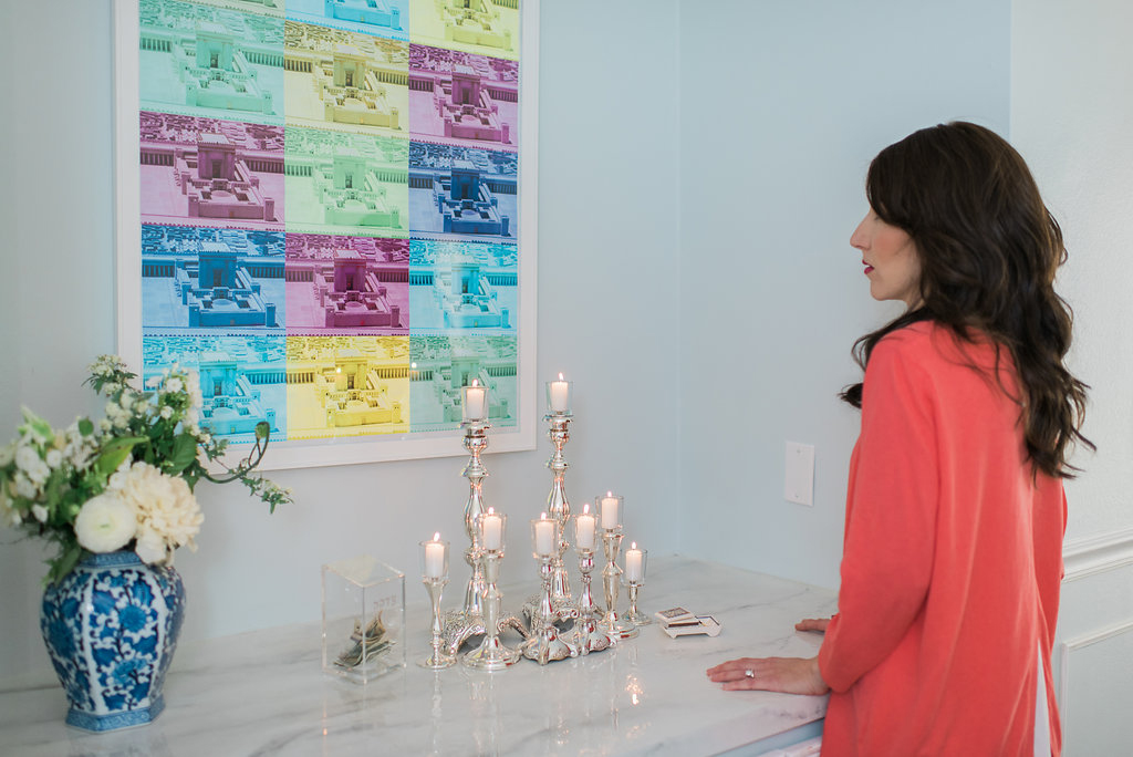 Woman lighting Shabbat Candles with pop art about second temple