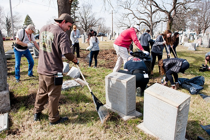 Volunteers cleaning up Mt. Carmel Cemetery