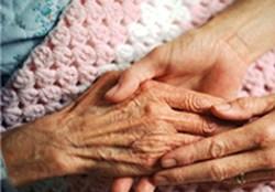 Caregiver hands with patient