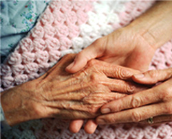 Caregiver hands with patient