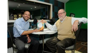 Rabbi Ben David, left, poses with his newest book, Seven Days, Many Voices: Insights into the Biblical Story of Creation, while taping this podcast interview with Rabbi Richard Address in the Professional Podcasts studios at The Lubetkin Media Companies, Cherry Hill, NJ