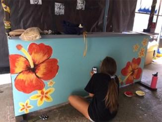 Sandy Taradash's granddaughter Shayna decorates a Homecoming float
