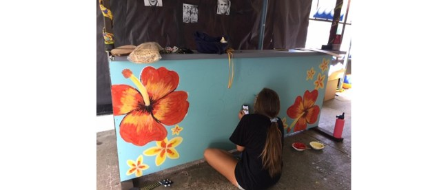 Sandy Taradash's granddaughter Shayna decorates a Homecoming float