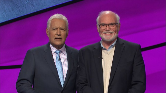 Cherry Hill resident Sid Katz, right, shown with Jeopardy! host Alex Trebeck, became the Jeopardy! champion in a match broadcast on March 16, 2020. (Photo courtesy Jeopardy Productions Inc.)