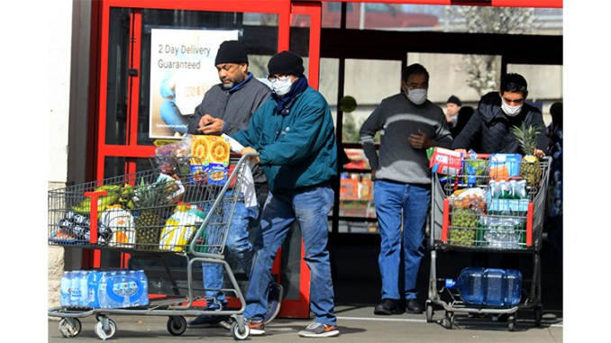 PARAMUS, NJ 03-21-2020 CORONAVIRUS OUTBREAK: Shoppers stock up on food and supplies at the BJ's warehouse club in Paramus on Saturday. The coronavirus outbreak has caused many to purchase an extra supplies. Many wore masks and gloves and practiced social distancing. -photo by Thomas E. Franklin
