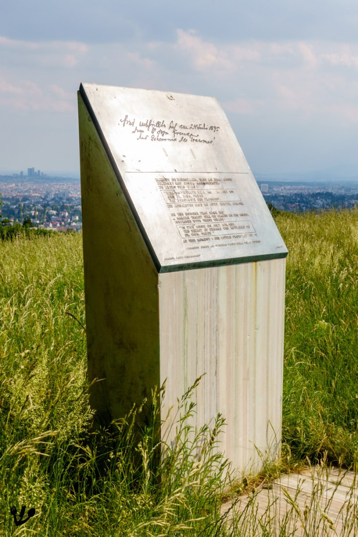 Sigmund Freud-Stele 'The Secret of Dreams' next to the Bellevuewiese, where Freud's favored hotel Bellevue used to be, with the city of Vienna in the background.