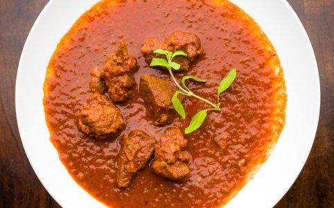 A plate with goulash (gulyás) Wiener Saftgulasch Vienna's gravy paprika beef stew