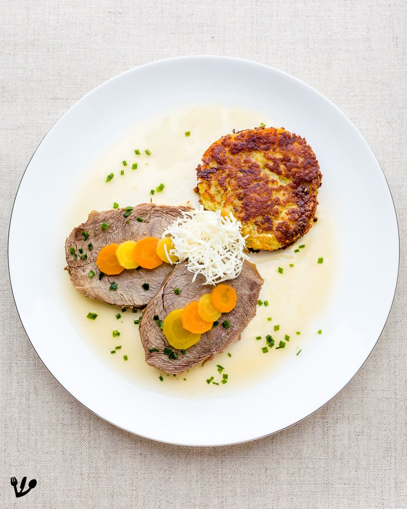 "This juicy, ""saftig"" in German (of utmost importance here!), and lean Viennese beef cut is called Mageres Meisel (or Mäuserl) and is a typical piece of meat served as boiled beef. Here I serve it with a small ladle of soup, topped with chives, coarse sea salt, alongside a potato rösti (a latke) and, of course, horseradish (I had my beloved apple-horseradish and beet-horseradish just outside the frame)."