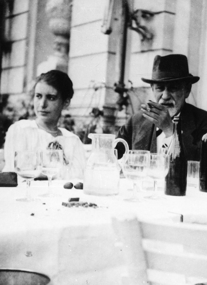 Remnants of a feast: Sigmund Freud and his daughter Anna sitting outside at a table with the remains of a meal from 1920.