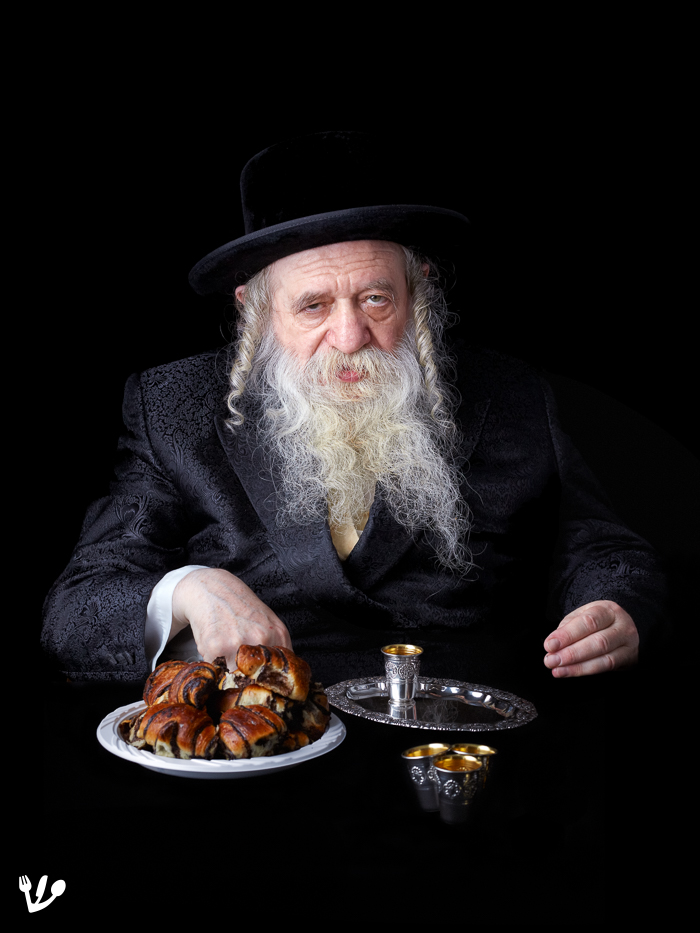 The Chernobyl Rabbi of Bnei-Brak at a Lechaim with rugelach in 2010.
