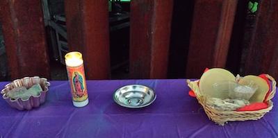 Interfaith service table at border wall - US side, Oct 8 2016, photo by Deborah Mayaan