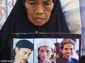 """The mother of two of the convicted bombers holds a poster of the three who were executed Sunday. Source <a href=""""http://edition.cnn.com/2008/WORLD/asiapcf/11/08/bali.bombings/"""" target=""""_blank"""">CNN</a>"""