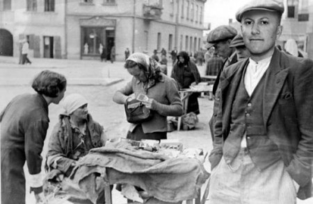 "Originally a photo of a Jewish man in the marketplace in the Jewish ghetto of Tarnow, Poland. On the eve of World War II, 25,000 Jews were living in Tarnow (55 percent of the local population). On February 9, 1944, the city was declared to be ""Judenrein""- free of Jews."