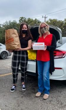 social service team delivers food