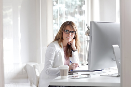 Virtual Assistant Sitting at Her Desk