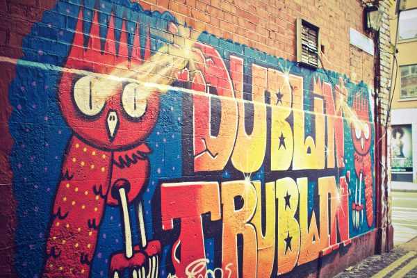Art and Graffiti on a Wall of Bow Lane East in Dublin, Ireland