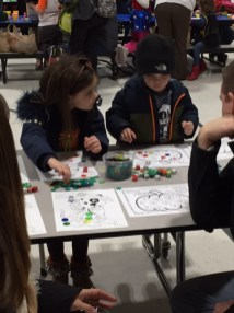 Kindergarten student Cypress Brunelle with her younger brother, Cayman doing an activity promoting Math skills. (Courtesy Photo)