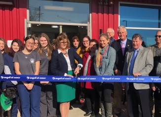Superintendent Heidi Riccio, surrounded by local legislators and representatives, students, staff and Angell Medical Center officials, cuts the ceremonial ribbon to the new Angell at Essex animal clinic. (Courtesy Photo Essex Tech)